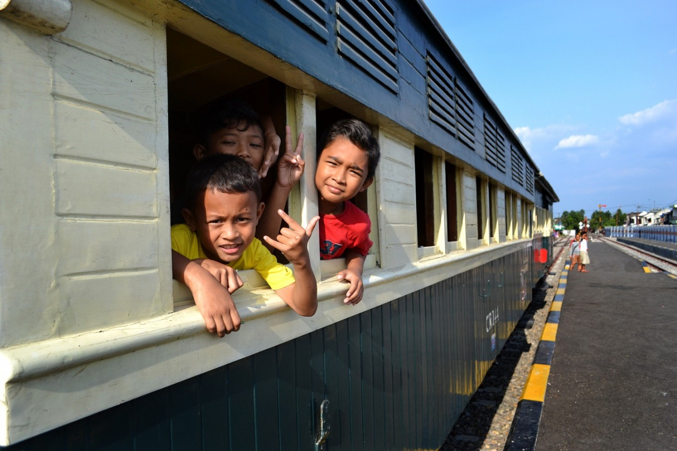 Children ride the Jaladara steam train in Surakarta, Central Java.