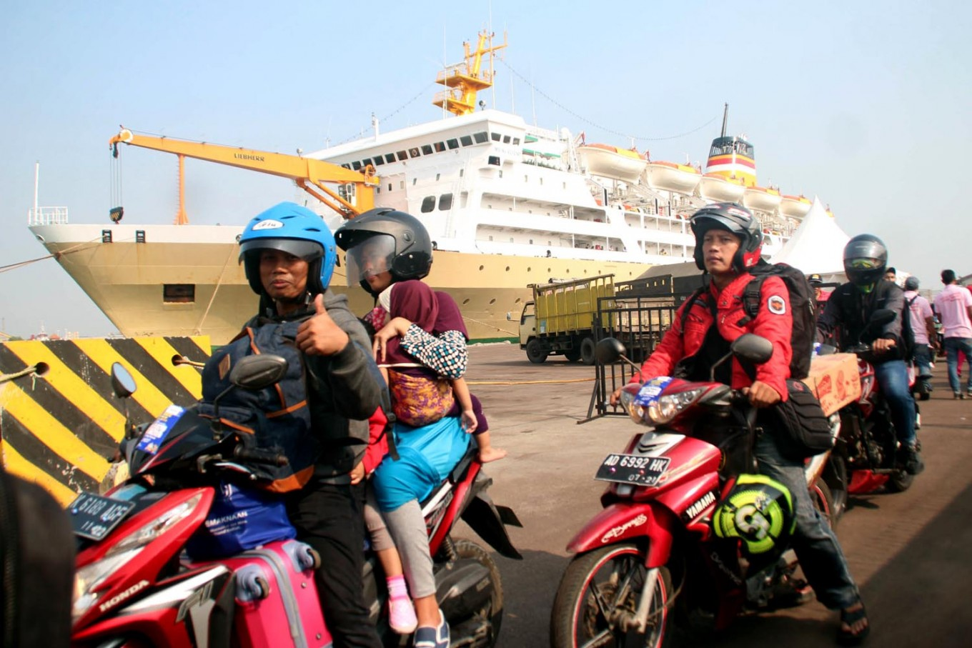 Across the sea: Families ride on motorcycles to their free ferry rides during mudik (exodus). JP/Suherdjoko