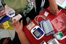 Health check: Drivers check their blood pressure to make sure they can safely drive during the 2018 Idul Fitri exodus. JP/ Seto Wardhana