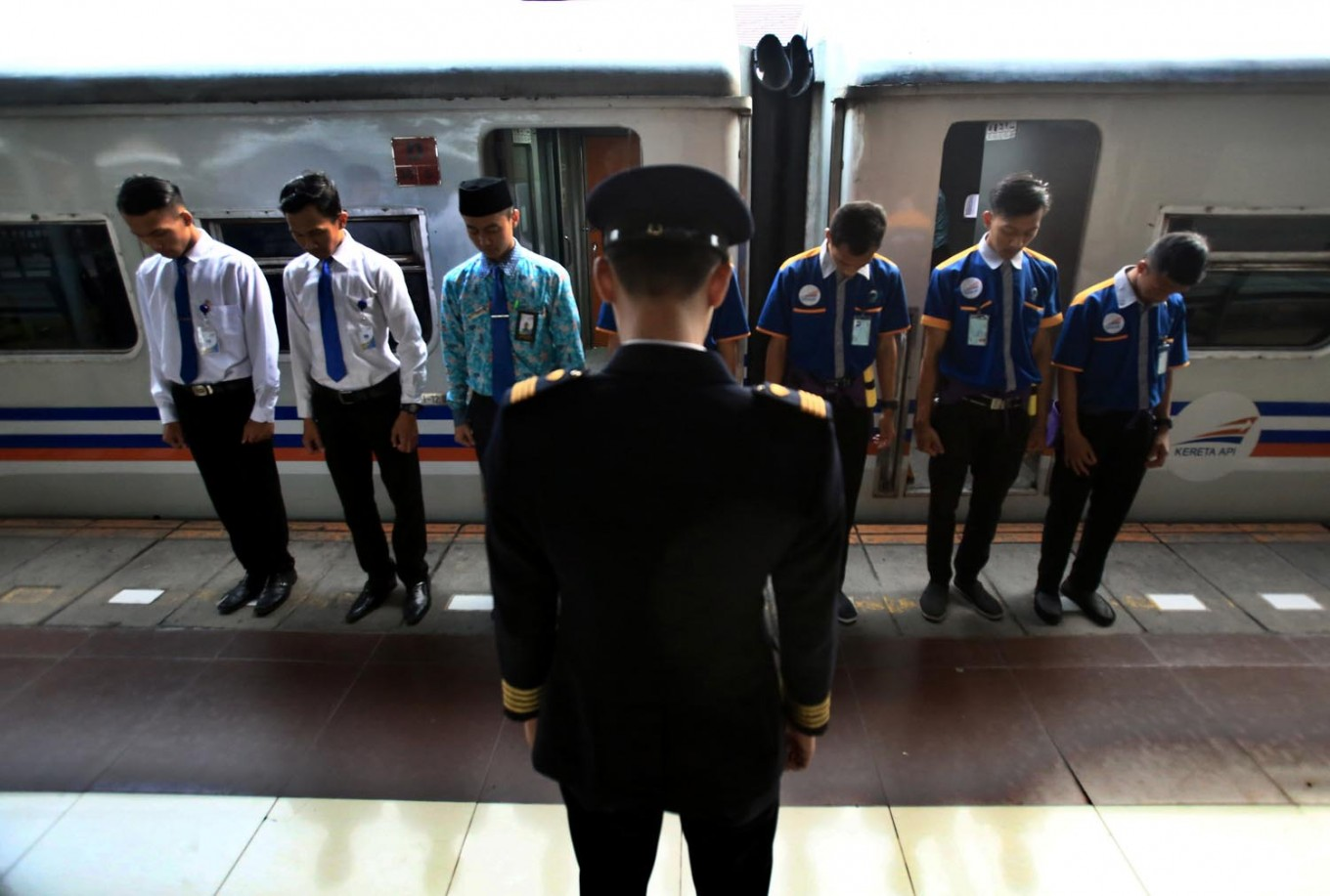 Bless us: A train conductor leads a prayer with his staff before they leave from Pasar Senen Station in Jakarta to Malang in East Java.JP/Dhoni Setiawan