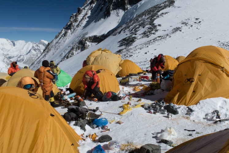 This handout picture taken on May 20, 2018 and released on June 12 by Damian Benegas shows discarded climbing equipment and rubbish scattered around Camp 4 of Mount Everest. Decades of commercial mountaineering have turned Mount Everest into the world's highest rubbish dump as an increasing number of big-spending climbers pay little attention to the ugly footprint they leave behind.