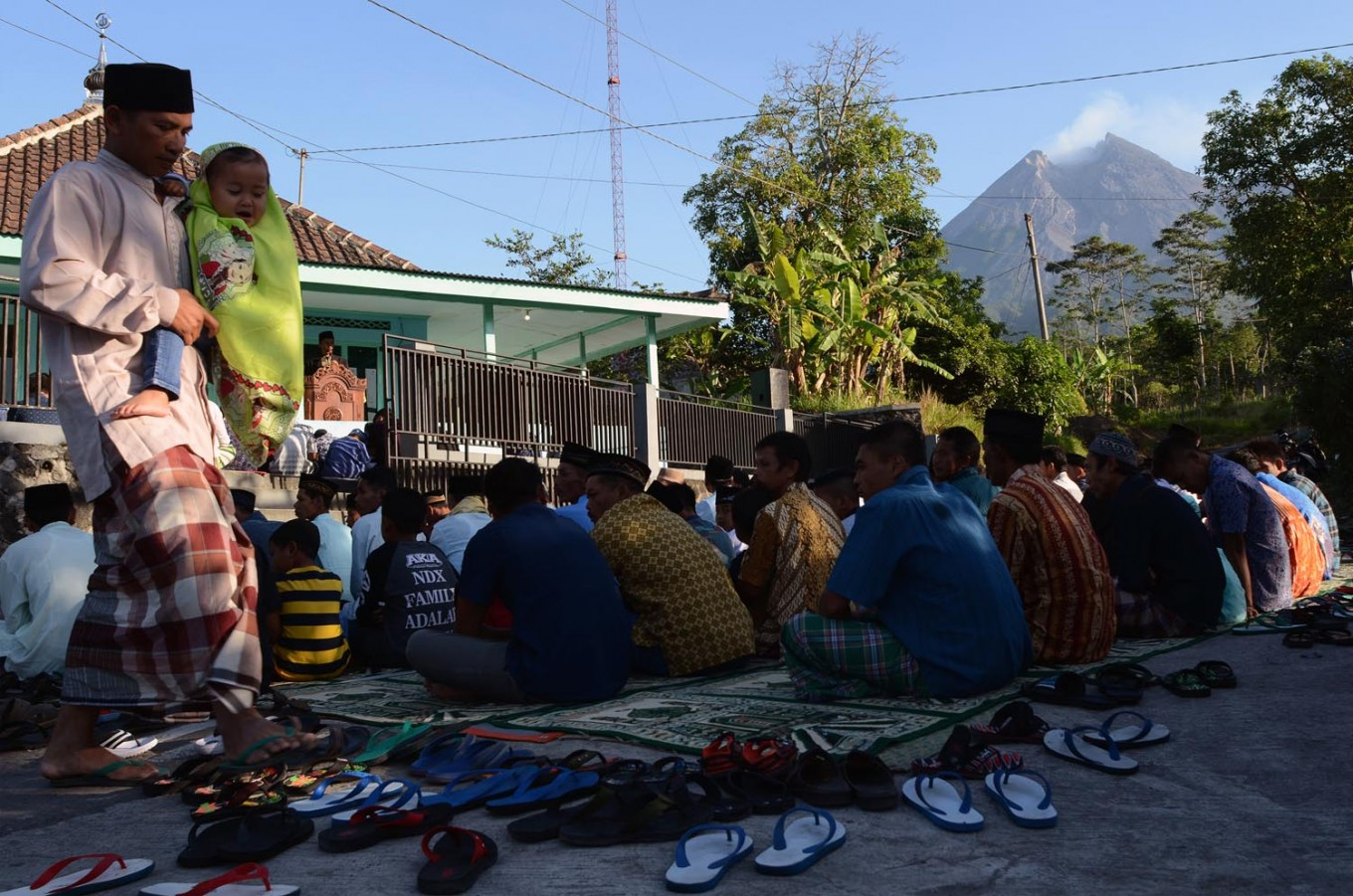 Residents of Balerante, Kemalang, Klaten regency in Central Java attend Friday prayers on June 15, 2018 in the front yard of Al Qodar Mosque. After praying, the villagers, who live on the foot of Mount Merapi, visit relatives' houses. JP/Magnus Hendratmo