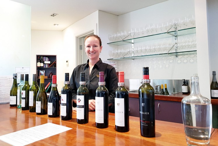 Pick your favorite: A cellar door assistant shows a selection of wines for tasting by Hollick Estates.