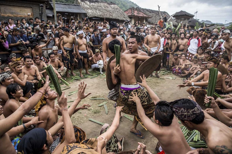 All out: Tengananese men fight each other in the middle of a crowd during Mekarekare (Pandanus Battle) in Tenganan Pegringsingan village in Karangasem, Bali. JP/Agung Parameswara