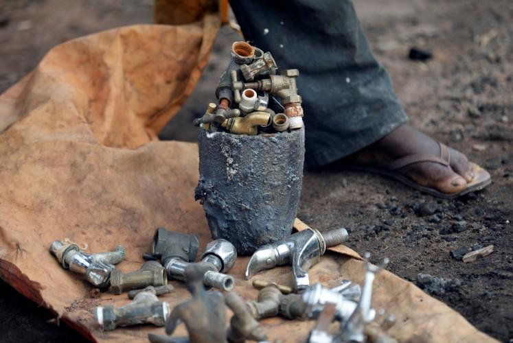 Tap heads are seen prepared as bronze materials at a melting site on Igun street in Benin City, Edo state, Nigeria June 13, 2018.