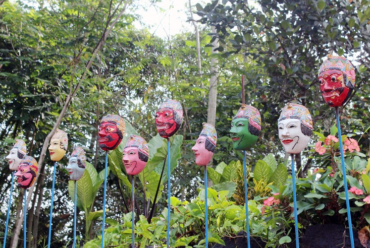 In a row: Kampung Topeng in Tlogowaru, Malang, East Java, proudly displays numerous dance masks.