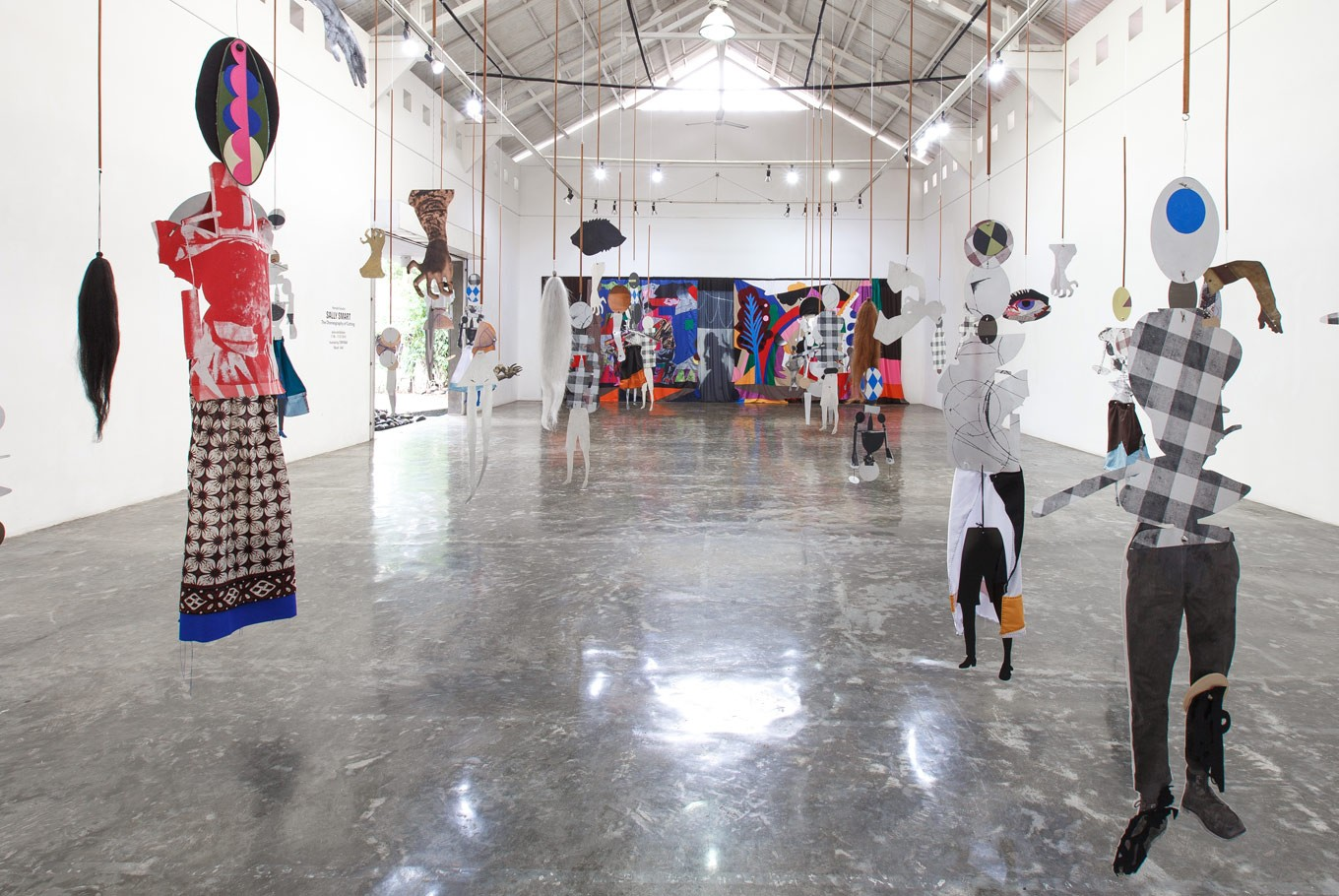 Puppets are suspended at the Tony Raka Art Gallery in Sally Smart's solo exhibit, 'The Choreography of Cutting'.