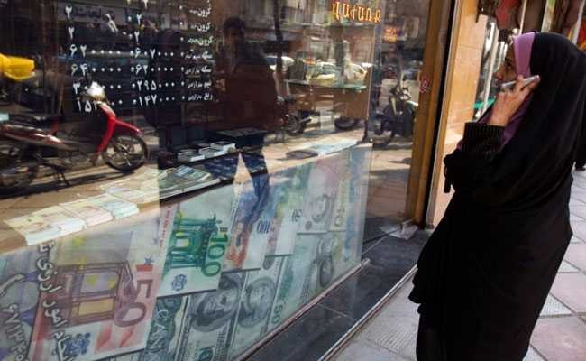 Iran bans 1,300 imports as protesters, police clash over currency weakness