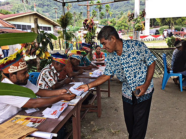 Traditional dress brighten up Papua polling station