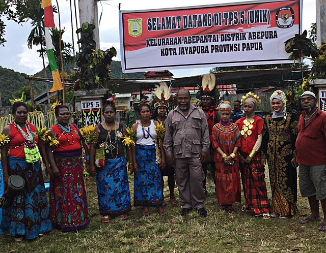 Diversity: Election officials in traditional dress from across the country pose for a group photo on June 27 at polling station TPS 005 in Awiyo subdistrict, Abepura district, Jayapura.