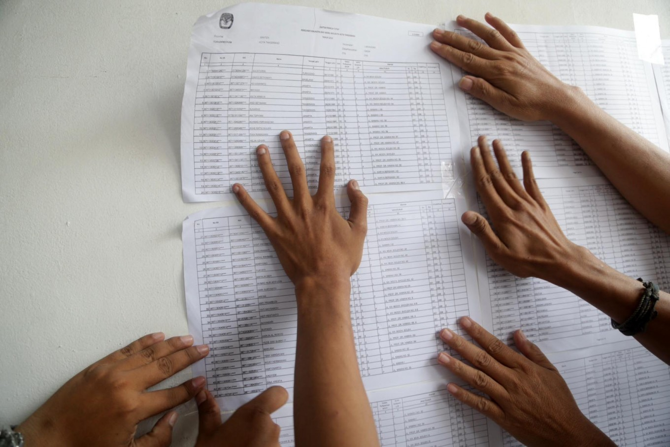 Polling station officials put up the eligible voter list in Kampung Gaga, Larangan, Tangerang regency, Banten, on Tuesday, June 26, 2018. A total of 323 voters were slated to cast their votes at the polling station. JP/Wendra Ajistyatama