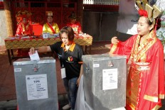 Polling station officials in Cibadak subdistrict, Astana Anyar district, Bandung, are wearing Chinese royal costumes on voting day on Wednesday, June 27, 2018. JP/Arya Dipa