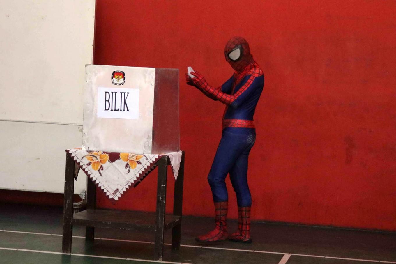 """Spiderman"" casts his vote in the Central Java gubernatorial election in Larangan Gayam subdistrict, Sukoharjo regency, Central Java on Wednesday, June 27, 2018. JP/ Maksum Nur Fauzan"