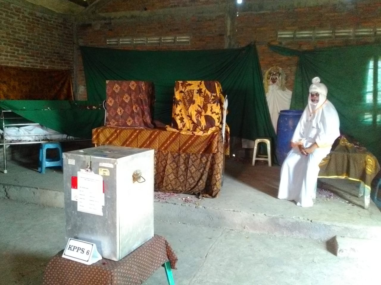 A polling station official is dressed as a ghost at Randusari polling station in Semarang, Central Java, on Wednesday, June 27, 2018. The station is located in the middle of Bergota cemetery. JP/Suherdjoko