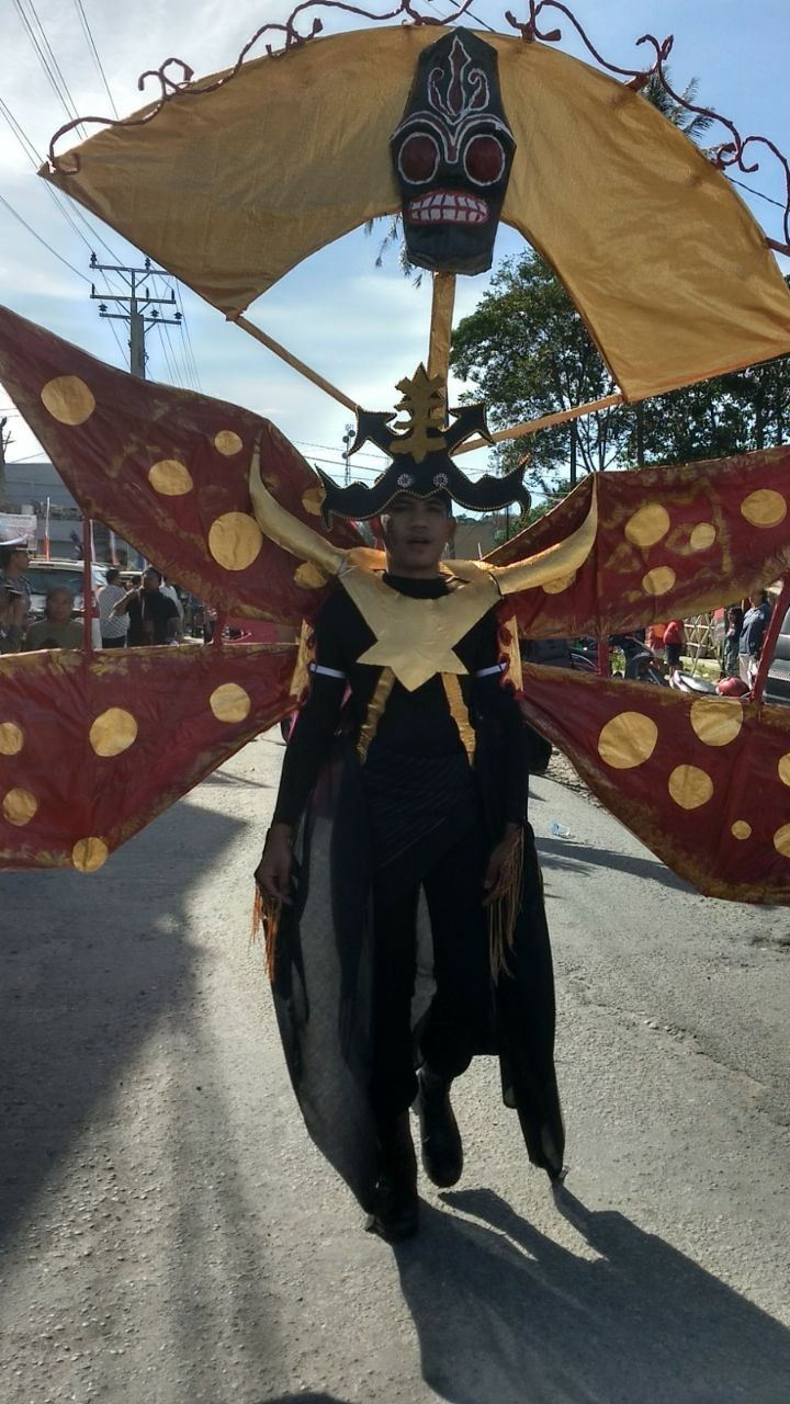 A costumed man takes part in a parade at Sigale-gale Carnival.