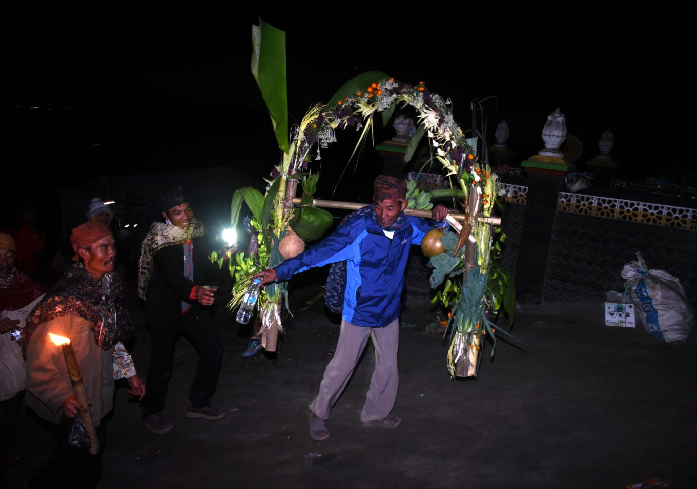 Offerings are carried early in the morning to the crater of Mount Bromo.