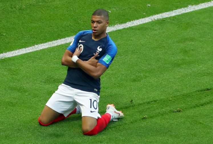 France's Kylian Mbappe celebrates after scoring their third goal while playing against Argentina in 2018 FIFA World Cup last 16 round soccer match at Kazan Arena in Kazan, Russia on Saturday. France won 4-3 to advance to quarterfinals.