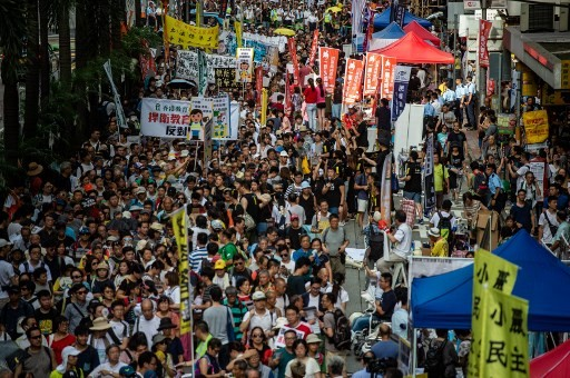 Thousands march in Hong Kong as restrictions grow