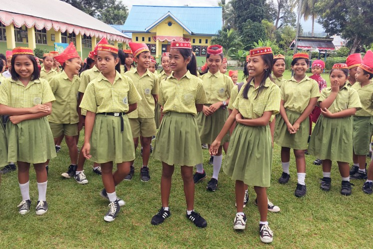Pride of the tribe: Schoolchildren wear traditional headbands.