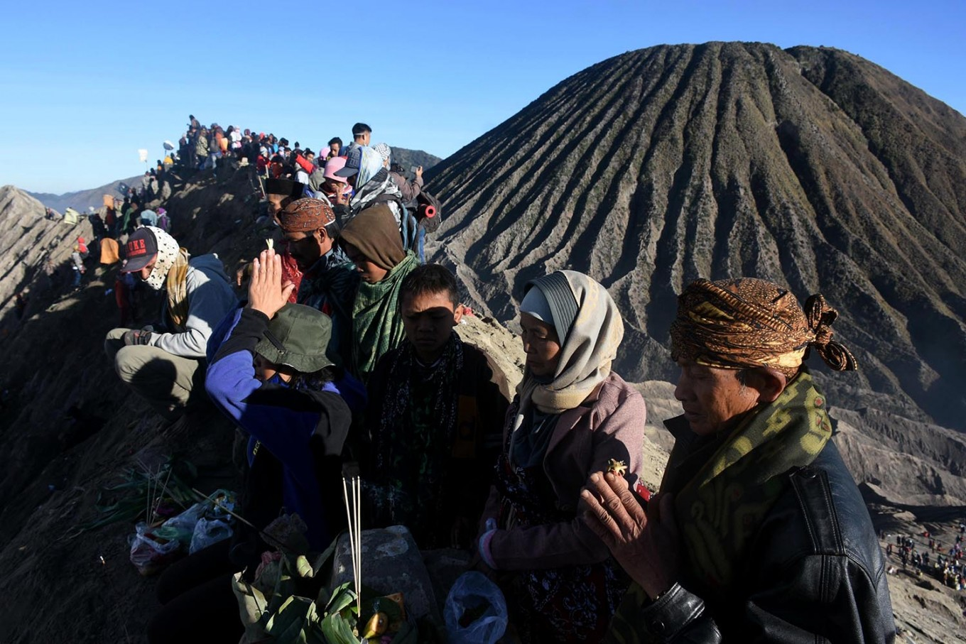 Give thanks: The Tengger people of East Java pray on Mount Bromo as part of the Yadnya Kasada to show their ritual to show their gratitude to the gods. JP/ Aman Rochman