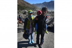 Bonding time: Supandi (right), a local shaman attends the Yadnya Kasada with his family. JP/ Aman Rochman