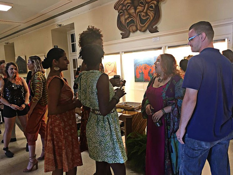 "Viewing beauty: Visitors are photographed during Saturday's opening reception for Srikandi 5's month-long ""Beautiful Indonesian Arts and Paintings Exhibition"" at the Niagara Arts & Cultural Center (NACC) in New York state."