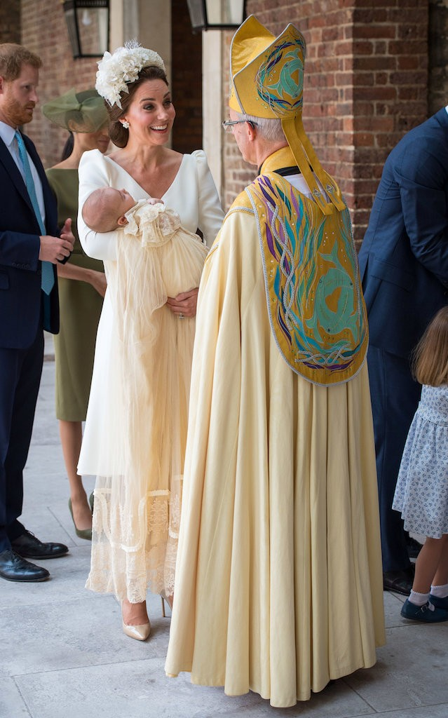 Britain's Catherine, the Duchess of Cambridge, speaks to Archbishop of Canterbury Justin Welby as she arrives carrying Prince Louis for his christening service at the Chapel Royal, St James's Palace, London, Britain, July 9
