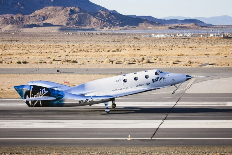 This December 3, 2016 handout photograph obtained courtesy of Virgin Galactic shows the Virgin Spaceship (VSS) Unity as it touches down after flying freely for the first time after being released from Virgin Mothership Eve (VMS Eve) in the Mojave Desert, California.