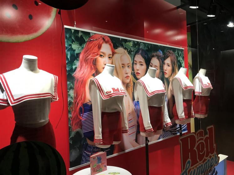 On display at SMTOWN are the cheerleader-inspired outfits that the girls of Red Velvet wore during their The Red Summer promotional period.