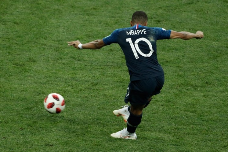 France's forward Kylian Mbappe shoots and scores a goal during the Russia 2018 World Cup final football match between France and Croatia at the Luzhniki Stadium in Moscow on July 15, 2018.
