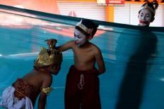 Three children rehearse while waiting for their turn to perform. JP/Maksum Nur Fauzan