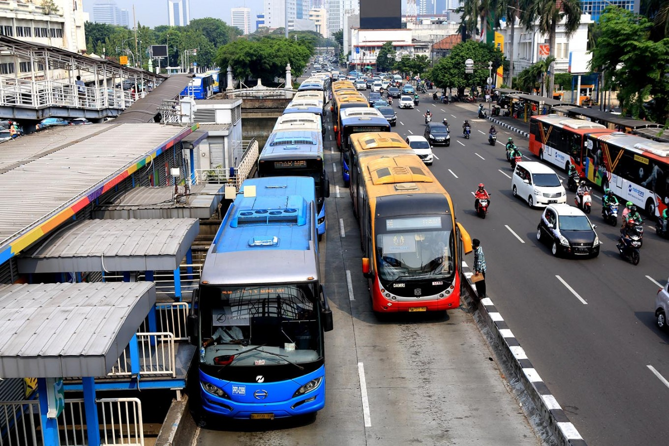 Transjakarta bus crashes to avoid hitting street sweeper