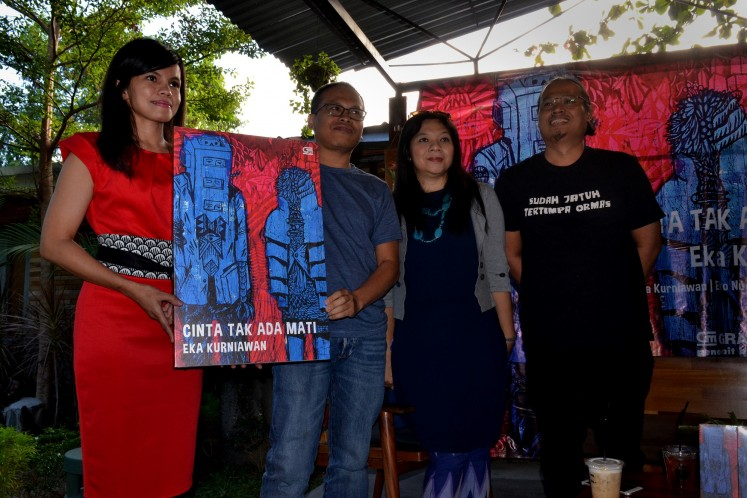"Eka, Alia Swastika (second from right) and Eko at the launch of ""Cinta Tak Ada Mati"", which was published by Gramedia Pustaka Utama."