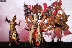 United: Dressed in colorful costumes, participants perform as part of the Solo Batik Carnival in Surakarta, Central Java. JP/ Maksum Nur Fauzan