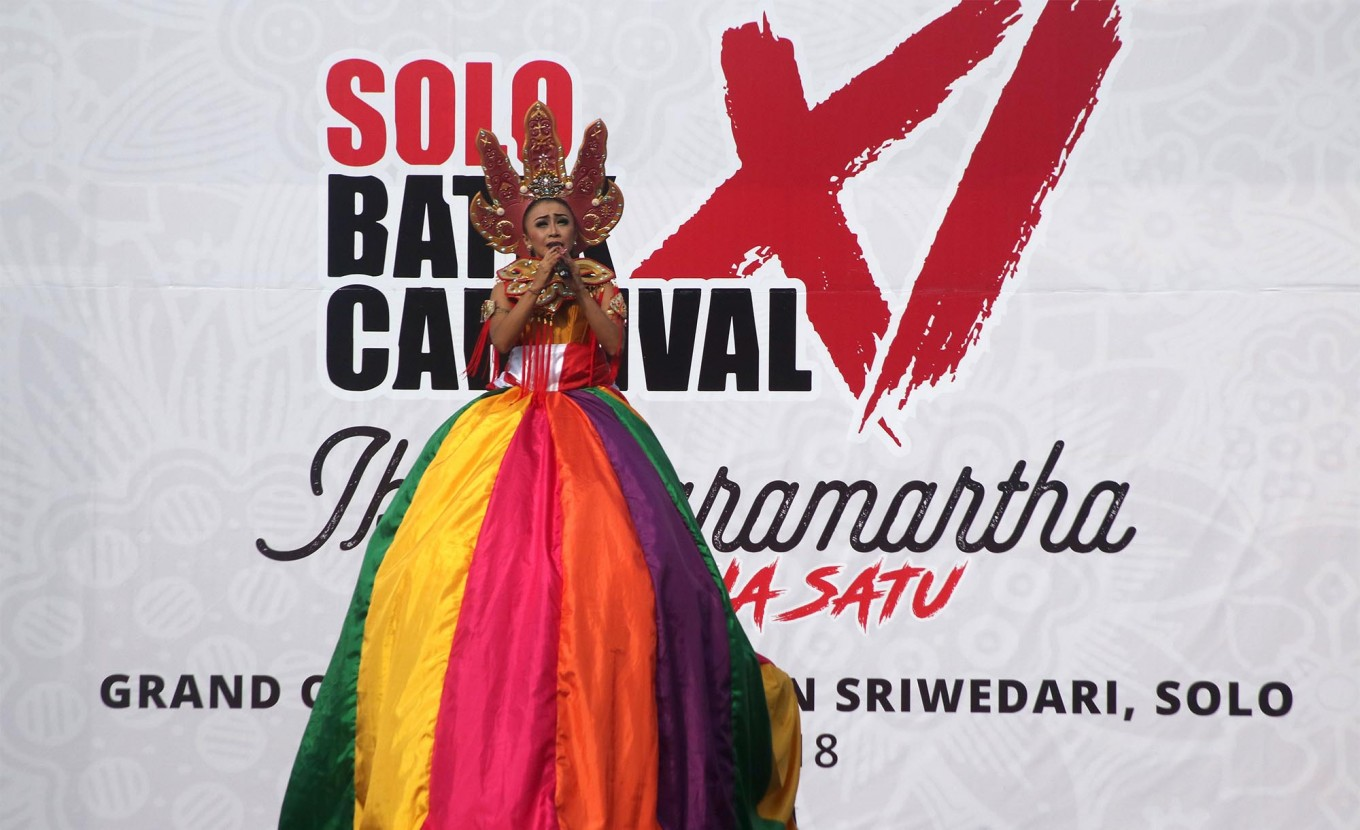 Song to remember: Clad in a vibrant costume, singer Trie Utami entertains the Carnival's audience with her hit songs. JP/ Maksum Nur Fauzan