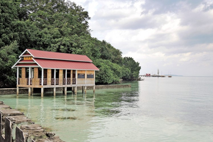 Dock on the bay: A lone house sits by one of Baubau's docks.