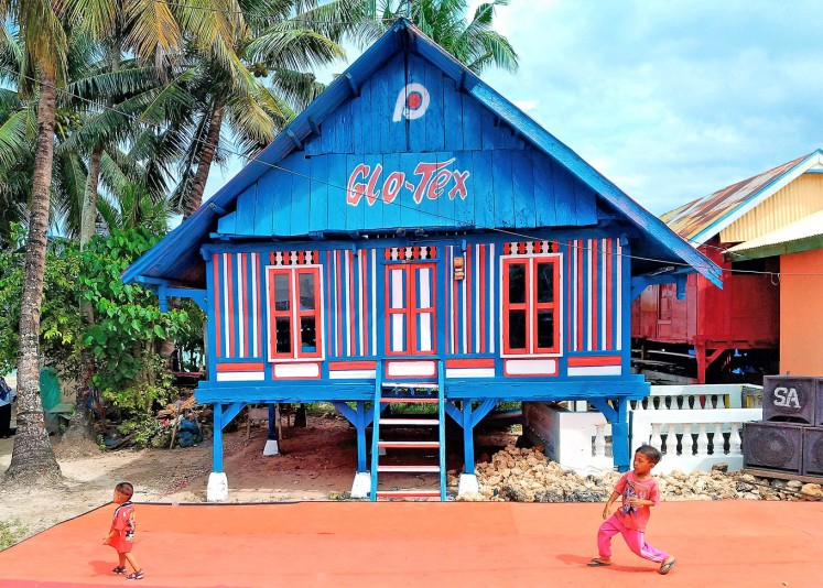 Charming: A traditional house has been painted in the island's textile colors by paint company Pacific Paint.