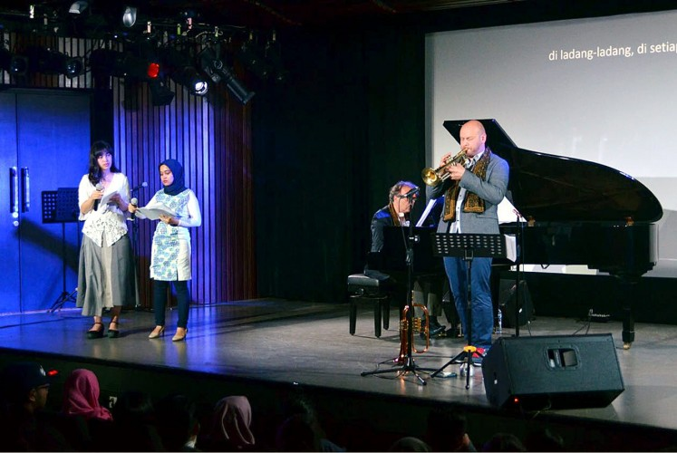 Message: Poem readers Amanda Ariawan and Meutia Delia (from left to right), pianist Alessandro Collina and trumpeter Marco Vezzoso perform Giannino Balbis' poem dedicated to the Nice attack.