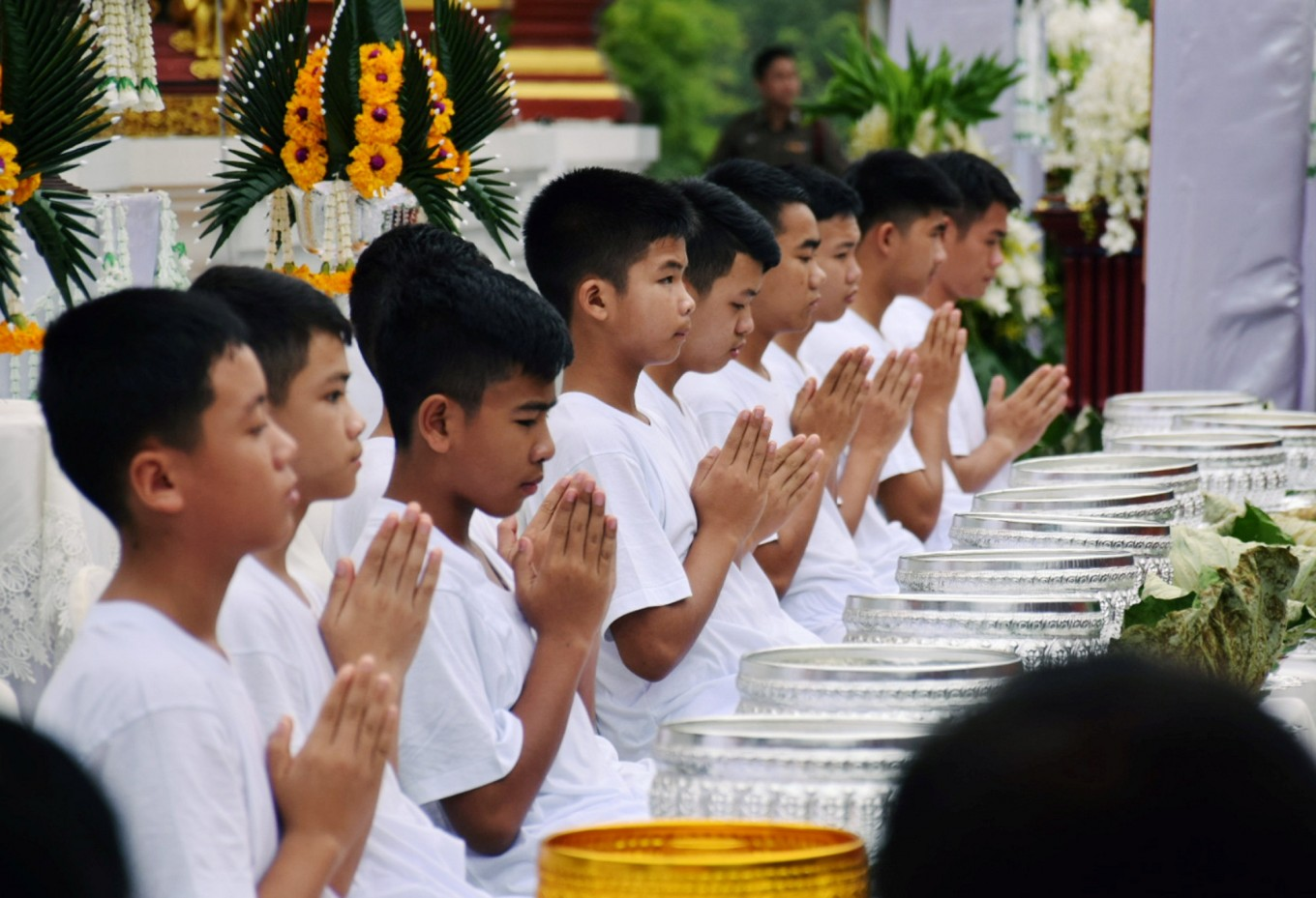 Thai cave boys begin ceremony to become Buddhist novices