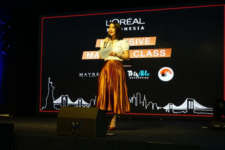 Melanie Masriel, L'Oreal Indonesia's communications, public affairs and sustainability director, gives a speech before the event.