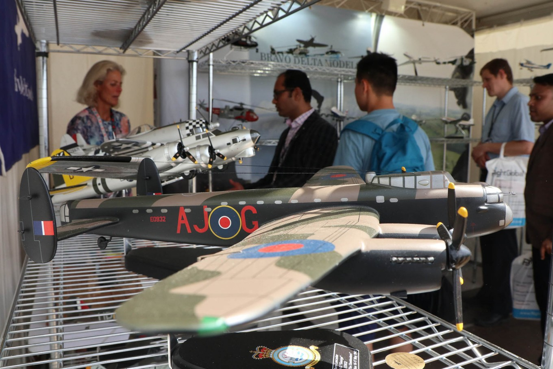 Model planes: Visitors stand near miniature planes at the Farnborough International Airshow. JP/ R. Berto Wedhatama