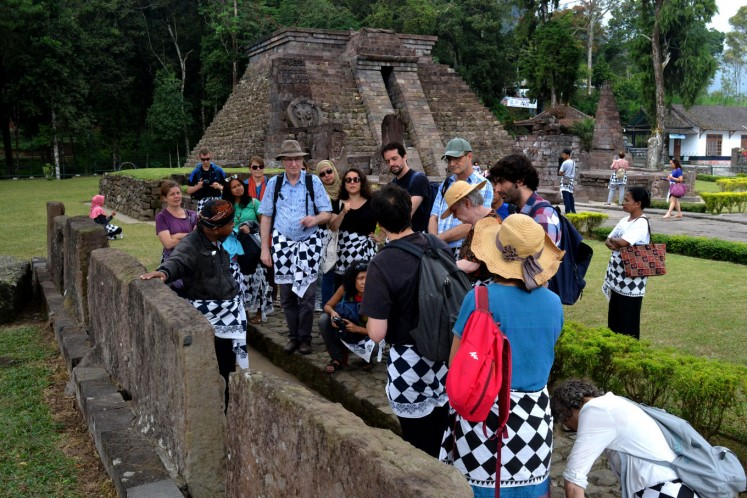 French students studying Javanese cultural history and philosophy at the Sukuh temple, Karanganyar regency, Central Java.