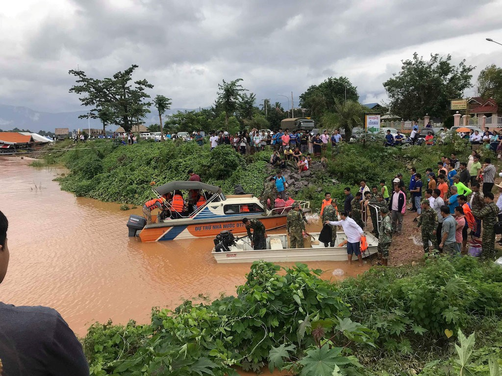After dam burst in Laos, a scramble for food, medicines and coffins