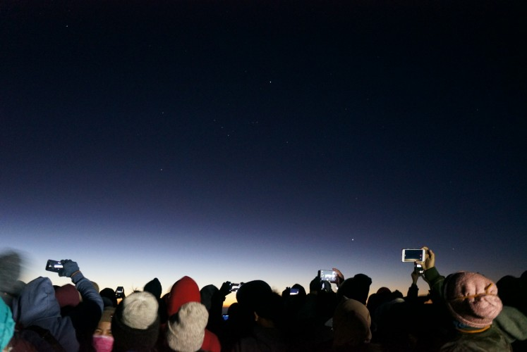 Under the starry sky: Tourists try to capture the beauty of sunrise at Penanjakan 1 at Bromo Tengger Semeru National Park (TNBTS).