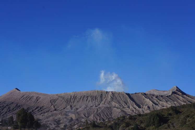 White ash exits Mount Bromo's crater.