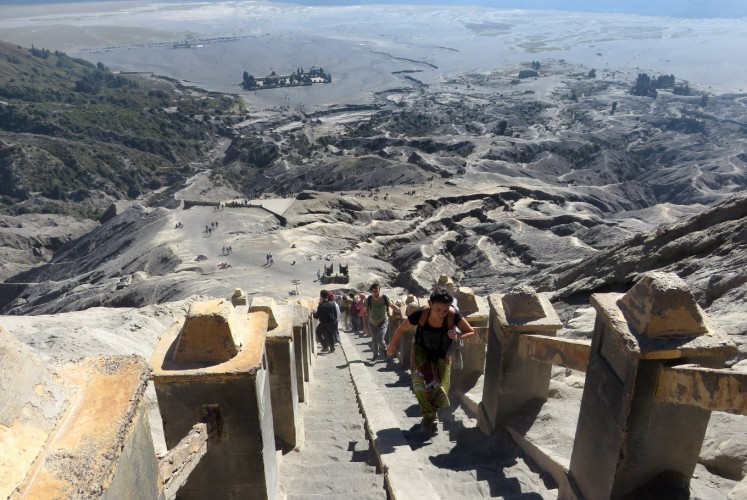 Tourists have to climb around 250 stairs to reach Mount Bromo's crater.