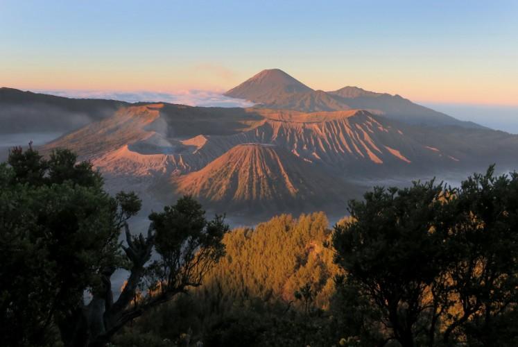 The view of four mountains; Mount Bromo (left), Mount Batok (front), Mount Widodaren (right) and Mount Semeru (behind) as seen from Penanjakan 1 view point at Bromo Tengger Semeru National Park (TNBTS).