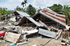 Homes are left destroyed in Sajang village, East Lombok, West Nusa Tenggara, after a 6.4-magnitude earthquake hit the province on July 30, 2018. Antara/Akbar Nugroho Gumay