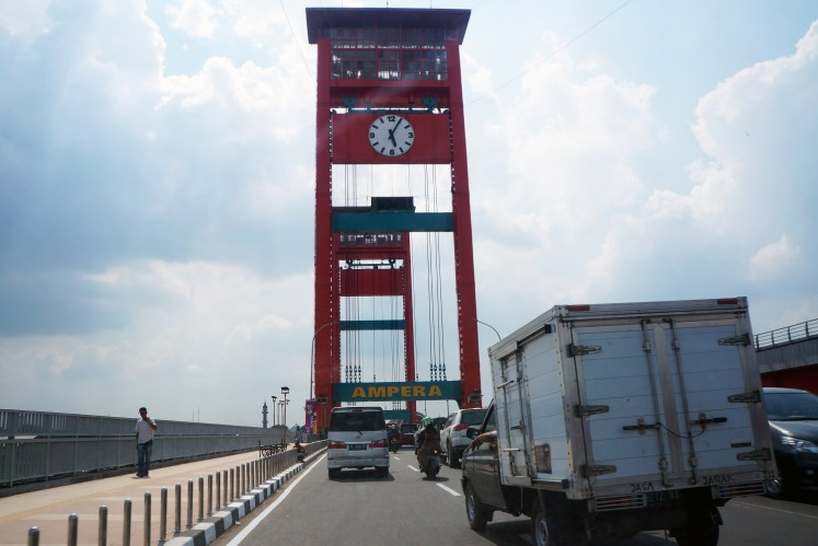 Ampera Bridge connects Palembang's Ulu and Ilir areas.