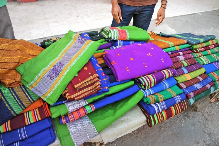 Up for grabs: Bolts of woven fabric are sold in a market in West Sumba, East Nusa Tenggara.
